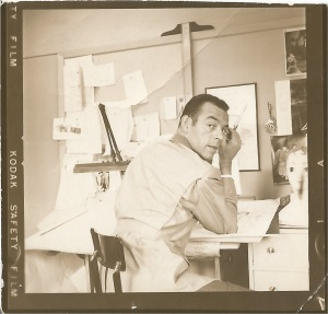 Mike Miksche poses in his studio during a photo shoot for Women's Wear Daily, 1955.